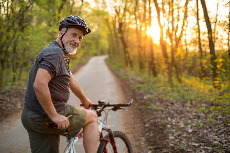 Photo of older man riding a bike