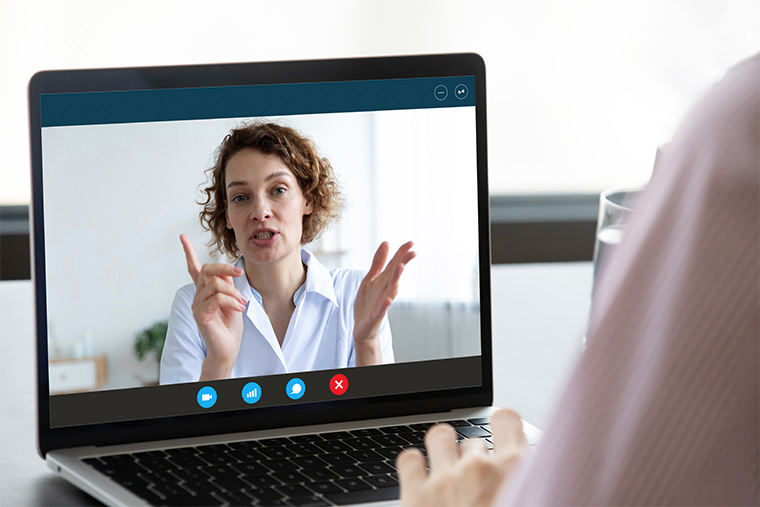 Image of computer screen with counselor speaking to person using computer
