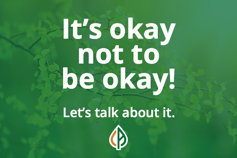 """Tree leaf branches with the words """"Its okay not to be okay!"""" on top with """"Let's talk about it"""" at the bottom"""